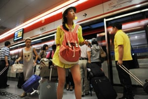 Passengers getting off and on a subway train in Beijing.