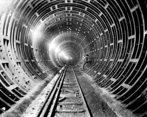 A workman caulks joints with lead to make them waterproof during the construction of the 6th Avenue subway tunnel in June 1939.