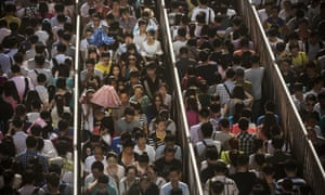 Chinese commuters line up for a security check to enter the Beijing subway system.
