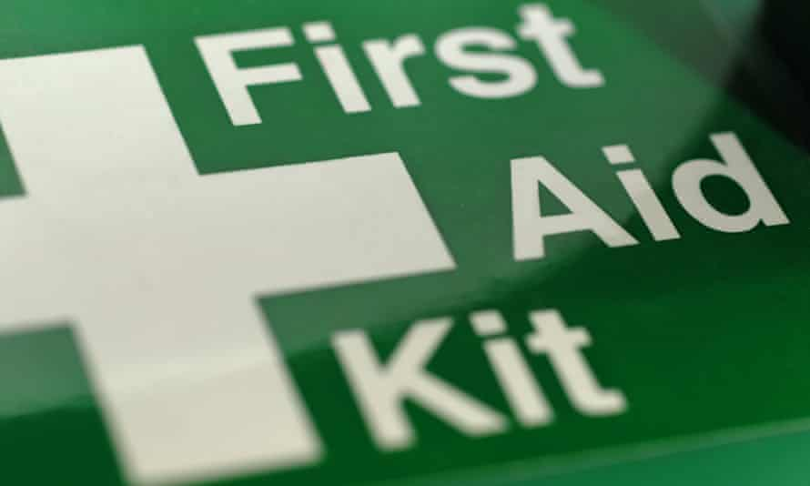 First aid kit in a green box.