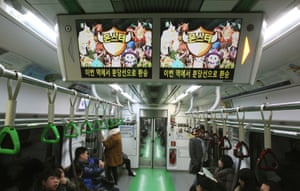 Screens advertising an online mobile game in a subway train in Seoul.