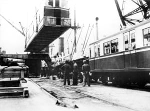 Wooden subway cars are unloaded, in Buenos Aires. Argentina, May 1934.