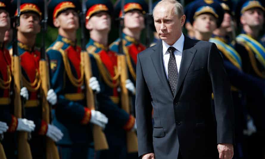 Vladimir Putin attends a WWII ceremony