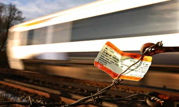 Railway ticket trapped in fence