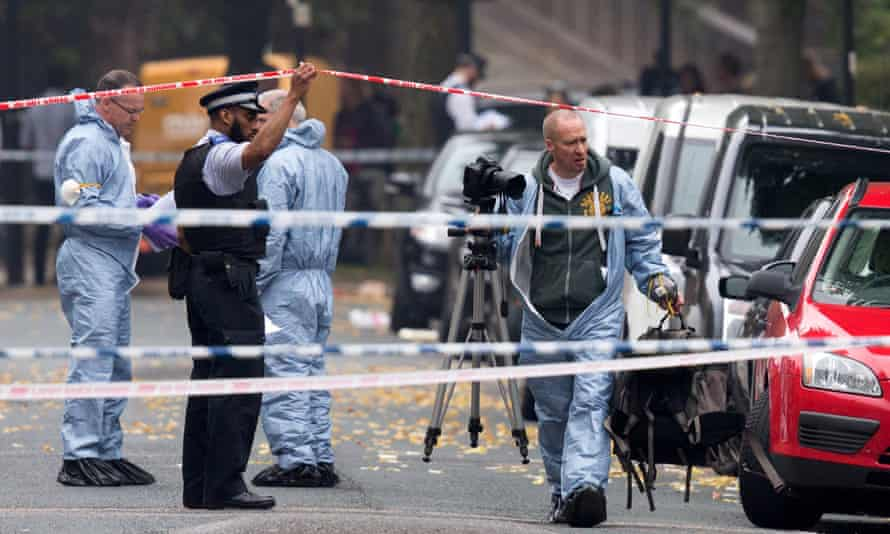 Forensic investigators prepare to examine a property in Islington where police officers shot dead a man who threatened a woman with a knife.
