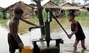 Boys at a water pump in Burma