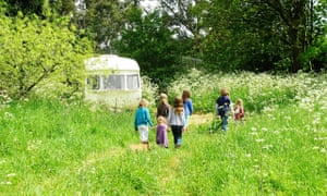 The vintage caravans are dotted around a meadow at Mad Dogs & Vintage Vans in the Wye Valley