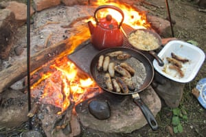 You can cook on a griddle over the campfire, or in the alfresco kitchen