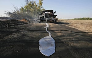 20 Photos: A puddle of melted material in front of a burned-out truck in Ukrainie