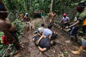 Ka'apor Indian warriors tie up loggers during a jungle expedition to search for and expel them from the Alto Turiacu Indian territory, near the Centro do Guilherme municipality in the northeast of Maranhao state in the Amazon basin, August 7, 2014.