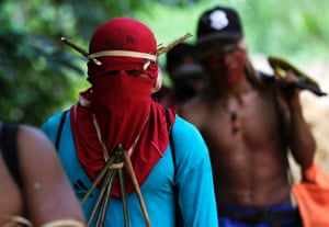 Ka'apor Indian warriors hike during a jungle expedition to search for and expel loggers from the Alto Turiacu Indian territory, near the Centro do Guilherme municipality in the northeast of Maranhao state in the Amazon basin, August 7, 2014.