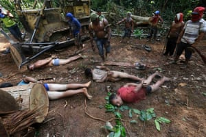 Ka'apor Indian warriors tie up loggers during a jungle expedition to search for and expel the loggers from the Alto Turiacu Indian territory, near the Centro do Guilherme municipality in the northeast of Maranhao state in the Amazon basin, August 7, 2014.