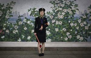 20 photos: A member of staff at a North Korean subway station
