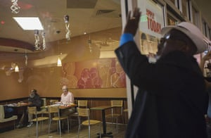 20 photos: Customers watch an activist bang on the window of McDonald's in Los Angeles