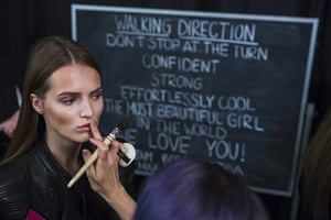 20 photos: A model has makeup applied backstage at New York fashion week