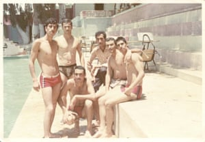 Young men standing by a pool in the 70s