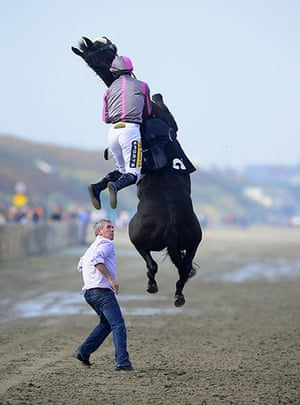 20 photos: Arbitrageur flies into the air while jockey Johnny King was trying to mount during the Laytown Races