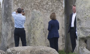 US President Barack Obama takes a photograph during a tour of Stonehenge.