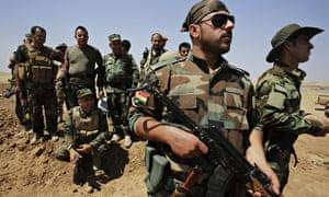 Kurdish Peshmerga forces guard their position at Omar Khaled village near Tal Afar, west of Mosul
