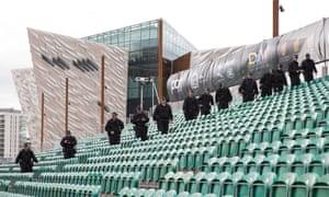 Police search the venue.