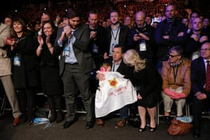 Frampton's daughter Carla doesn't seem too interested in the fight as she lays under her father's jacket.