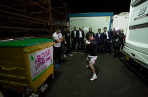 Frampton warms up outside his dressing room.