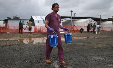 Buckets of blood carried across open ground to Ebola test lab