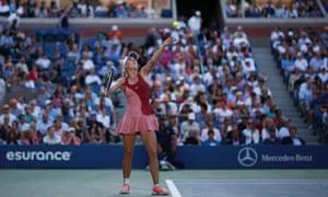 Wozniacki serves as the crowd look on.