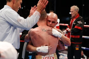 The fighters embrace at the end of a hard fought battle.