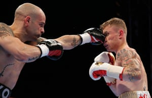 It's not all one way traffic, here Martínez catches Frampton on the nose.