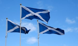 The Flag of Scotland, the Saltire, blows in the wind near Berwick-upon-Tweed on the border between England and Scotland on September 7.