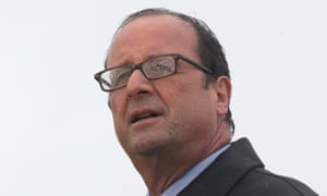 French President Francois Hollande delivers a speech in the rain on the Ile de Sein on August 25, 2014.