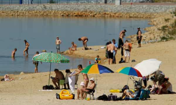 Bathers enjoy the water at a beach at Baerwalder See lake on August 21, 2010 near Boxberg, Germany.