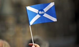 A supporter of Scottish independence holds a yes flag