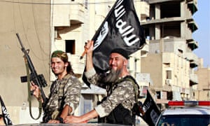 Islamic State fighters parade through Raqqa in Syria. One militant holds a US M16 assault rifle