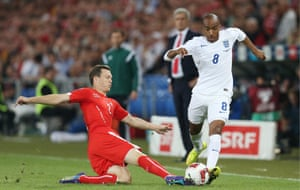 Fabian Delph has made a lively start, here evading the challenge from Stephan Lichtsteiner.