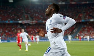 England's Danny Welbeck celebrates after scoring his side's first goal against Switzerland in their Euro 2016 qualifier.