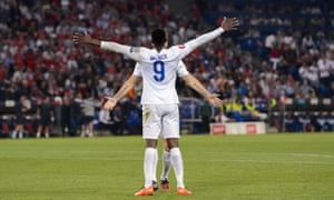 Welbeck celebrates with Rickie Lambert who provided the assist. Photograph: Fabrice Coffrini/AFP/Getty