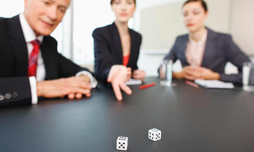 Business people throwing dice on conference room table. Image shot 2009. Exact date unknown.