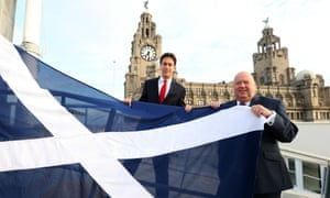 Liverpool City Council leader Joe Anderson and Labour leader, Ed Miliband raising a Saltire on Liverpool waterfront.