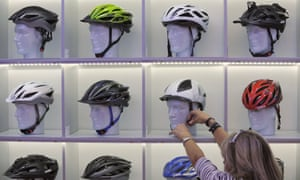A woman fastens a helmet from the German manufacterer Uvex onto a mannequin head at the Eurobike trade show in Friedrichshafen, Germany, 31 August 2011.