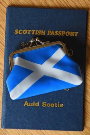 A Scottish passport holder and purse.