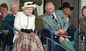 The Queen and the Prince of Wales watching the action during the Braemar Highland Games.