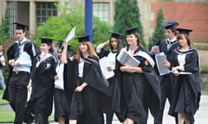 CELEBRATING GRADUATES FROM A BRITISH UNIVERSITY LEAVE GRADUATION CEREMONY WITH DEGREE CERTIFICATES
