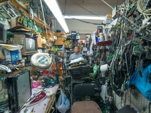Jose surrounded by electrical goods in New York City.