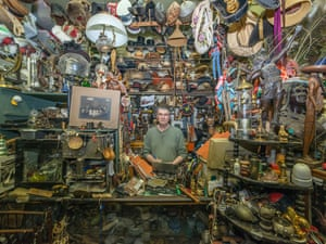 Richard is surrounded by hundreds of items in Montreal, Canada.