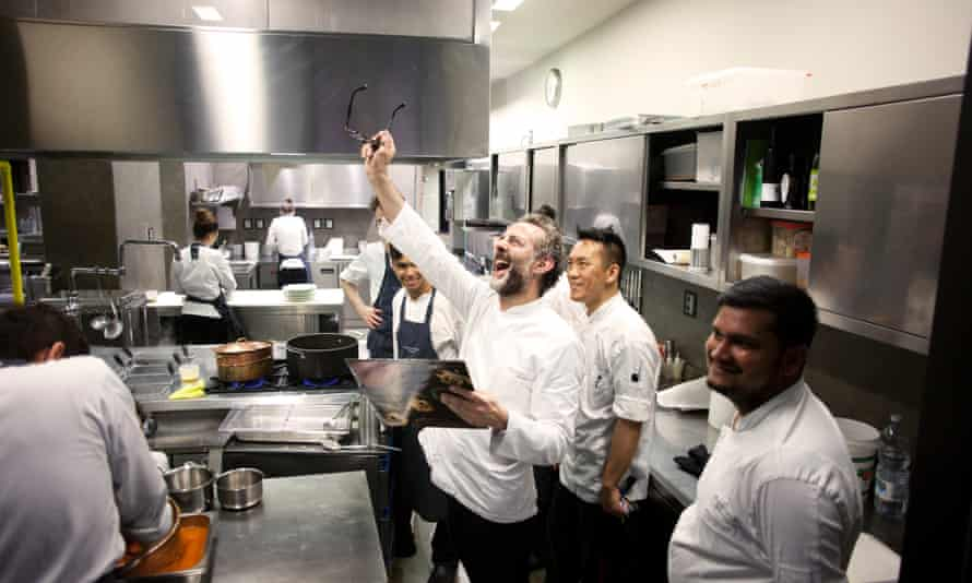 Massimo Bottura showing the Beatles' Rubber Soul in the kitchen.