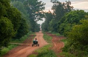Mennonite women driving their horse and cart through the Nueva Esperanza colony