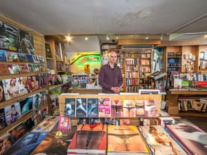Yacek stands amongst his wares of adult books and magazines in London.