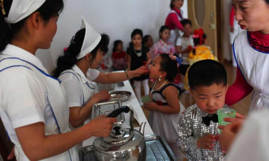 North Korean nurses give vitamin A supplements and deworming pills to children dressed in their best outfits at an elite nursery school in Pyongyang, North Korea.